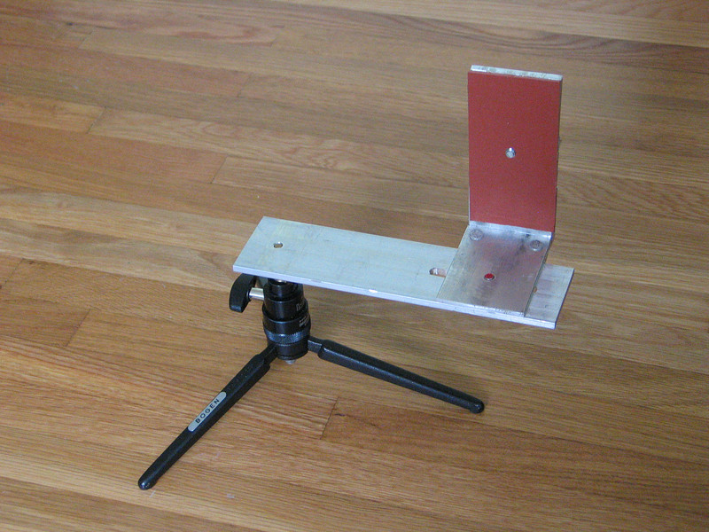 Travel bracket mounted on mini Bogen tripod. While this tripod cannot support the camera, it does allow me to rotate the camera vertically over the nodal point.