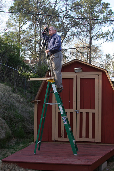 Old man on ladder.