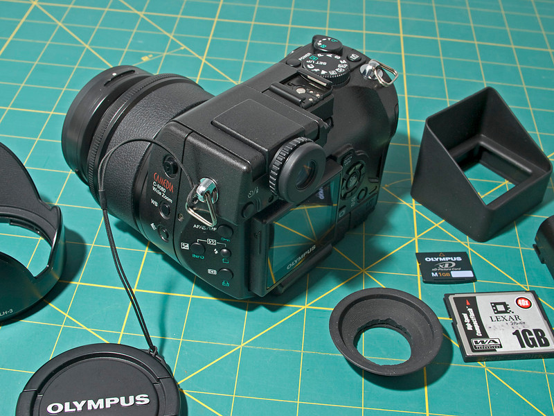 OLYMPUS DIGITAL CAMERA FOR SALE - Olympus C-8080 camera with a 28-140 mm f/2.4-3.5 lens - like new, in mint condition with all of the original accessories plus an auxiliary WCON 08D wide angle lens and many more accessories.