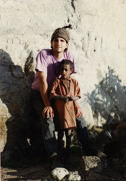 Andrew Goldman with child near the top of the mountain at Lalibela, Ethiopia