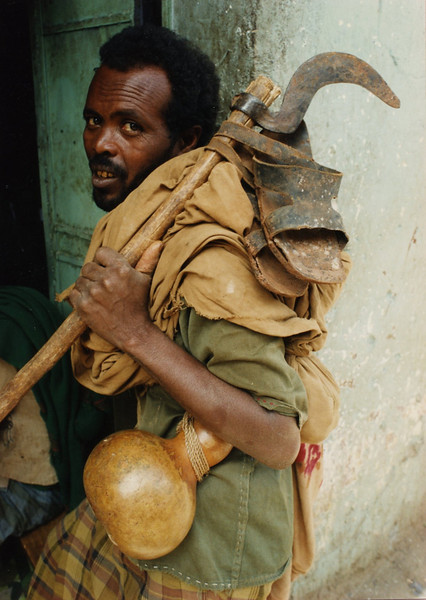 Man with hoe and gourd in Harar, Ethiopia
