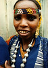 Woman with silver beads and head band in Harar, Ethiopia