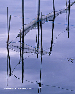 NETS REFLECTED IN LAGOON, SPAIN