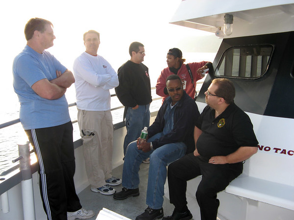 A breakout session to discuss the day is organized on the boat  Rich Glenn Joe Alethia Vince and John