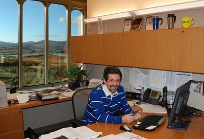 Joe in the windowed office he always wanted