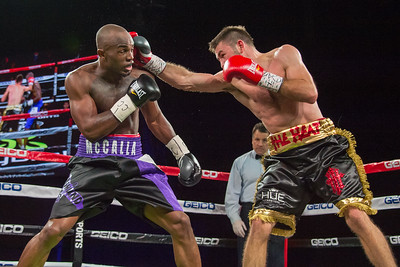 NEW YORK, NY - JANUARY 09:  Cecil McCalla (black/purple shorts) battles Chris Van Heerdan (black/gold shorts) during 2015 Throne Boxing Fight Night at The Theater at Madison Square Garden on January 9, 2015 in New York City. (Photo BleacherCreatures.tv/Corbis)