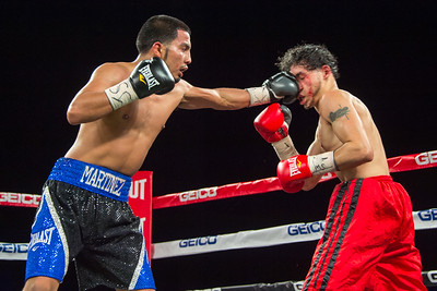 NEW YORK, NY - JANUARY 09:  Rigoberto Miranda (black/blue shorts) battles Eduardo Martinez (red shorts) during 2015 Throne Boxing Fight Night at The Theater at Madison Square Garden on January 9, 2015 in New York City. (Photo BleacherCreatures.tv/Corbis)