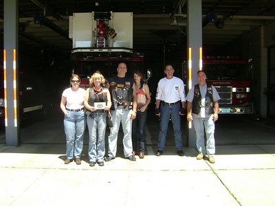 In front of a fire house with the door open