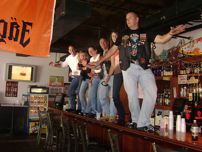 everyone dancing on a bar