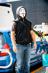 "A young man wears the mask of ""V""."