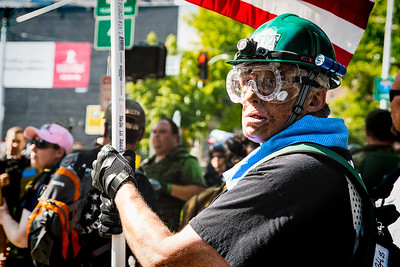 A Trump supporter is ready for pepper spray with his protective eye goggles.