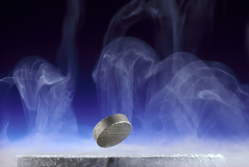 Superconductivity... Samarium Cobalt Magnet Floats over a Super Cooled Yttruim Barium Copper Oxide Composite Disc