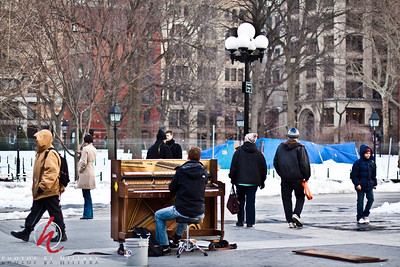 Taken 2.12.11  Washington Square  in Manhattan...such a hard, cold way to earn some money, but his music was wonderful filling the air as people walked through the square.