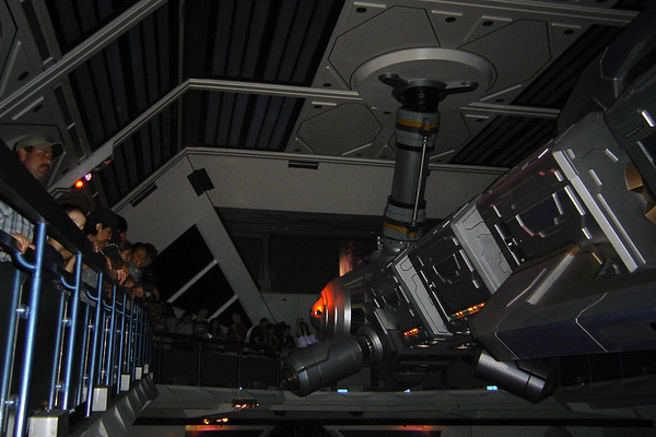 """Inside, they made significant changes to the halls (you can no longer see into or even hear the ride), space port (the space ship hanging over the launch area has been retrofitted and the large viewscreen now depicts orbitting a planet), and, while on the ride, you're treated to a new soundtrack, new lighting effects, and a really strong AC (""""It is very cold...in space"""")"""