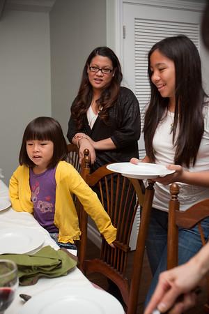 Kimi, Christine, and Hanh line up for dessert