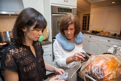 Valerie checks the bird's temperature