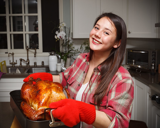 Charline poses with the bird...this will be her first Thanksgiving.  We're so happy that she is able to join us!