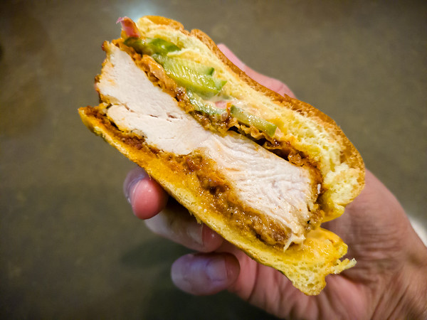Generous and juicy breast of chicken, with a nice crisp edge...medium is genuinely spice and probably our ideal level. The sweet bun provides a balance to the heat. Might be a tad salty, but otherwise delicious.