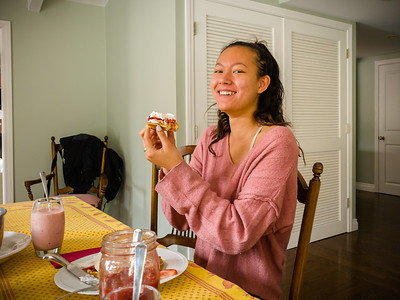 Jacqueline demonstrates her hands-on approach to eating strawberry waffles