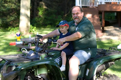 Uncle Bill and Owen going for a ride