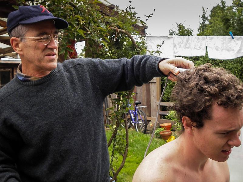 Roy cuts Gus's hair