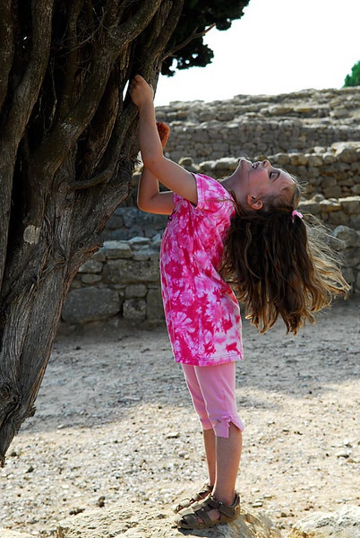 Julia trying to be a tree, roman ruins in Costa Brava Spain