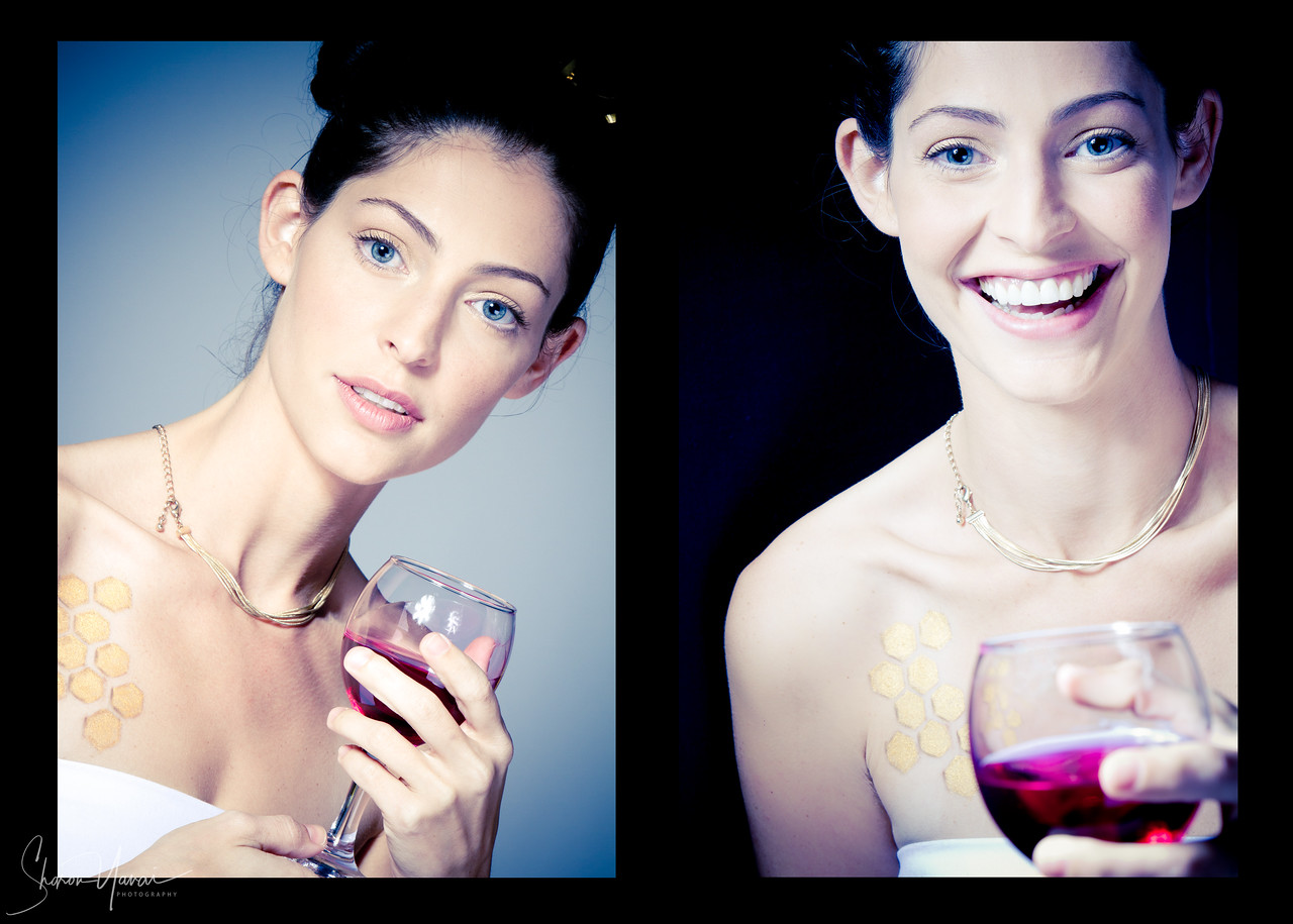 Beautiful model holding a glass of wine