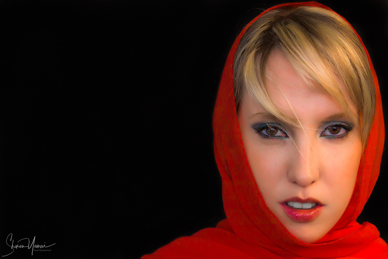 Beautiful model with red scarf on black background