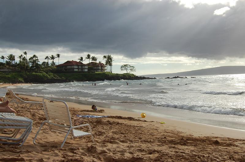 From the beach at Grand Wailea. We did some snorkeling off that point, and came pretty close to some really big sea turtles. There was a little bit of mist coming down and blowing toward the beach, at almost the same angle as the rays of light.
