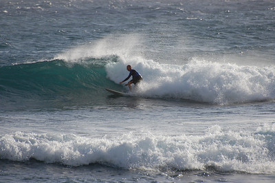 These were some surfers we saw while at a beach park on Kuai. Had the 70-300 lens on all the way out, and I could hardly make them out in the viewfinder.