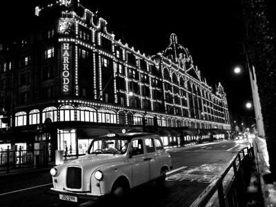 Harrods of London department and London taxi cab