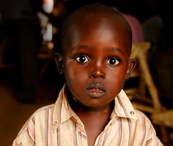 Rwanda refugee boy in Uganda camp.