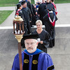 Dr. Clayton Jefford led the graduation procession into the Archabbey Church before the start of the seminarian graduation in May.