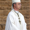 Archabbot Justin stood outside the Archabbey Church before the start of the seminarian graduation in May.