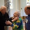 Archabbot Bonaventure Knaebel, OSB, congratulated Helen Haggard, center, and Jerry Gorup, right, after they made their oblation in the Archabbey Church in June.