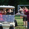 """Fr. Godfrey Mullen, OSB, gave high-fives to the college ministerial interns after they scored a goal in the Ultimate Frisbee game against """"One Bread, One Cup"""" participants on June 14."""