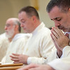 Fr. Joe Moriarty prayed during the deacon ordination on April 6.