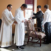 Seminarians Mauricio Abeldano Flores, from left, Michael Moon, Elijah Cho and Ben Syberg help each other prepare for the deacon ordination on April 6.