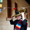 "Seminarian Br. Macario Martinez-Arjona, OSB, tried on a sombrero before the ""Around the World"" event on April 11."