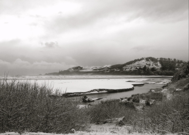 We had snow today! On the beach, even. Here's picture of Yaquina Head, as viewed from Agate Beach, B&W version.