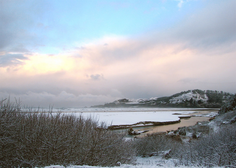 We had snow today! On the beach, even. Here's picture of Yaquina Head, as viewed from Agate Beach.