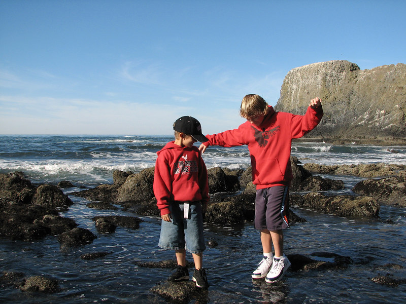 Micah & Hunter about to fall into the tide pools at Yaquina Head.