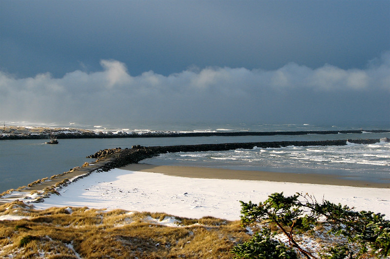 A fishing boat heading out (probably to Alaska) on our first snow-covered morning in at least a decade.