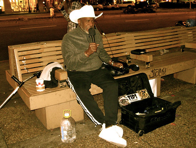 A street performer sits down to get into the groove. Berkeley, Calif., November 2010.