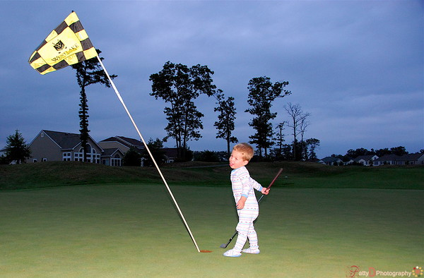 This photo was entered in the Fred Miranda Weekly contest for Miniature.  <br /> It was titled 'Miniature Golfer'
