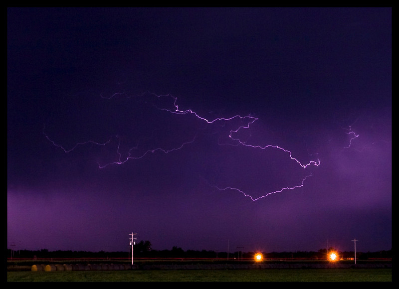 Nebraska Thunderstorm - Lexington Nebraska.     This was a fun shot to do.   The lightening was really intense.   But the mosquitoes chewing on me were even more intense.   Evidently they had not eaten in several days.   Glad I could provide them with some nourishment.