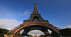 The lattice design of the Eiffel Tower is quite strong, and is one of the most efficient shapes in architecture. Though it is 1053 feet high, the Tower only weighs 7300 tons. If you melted down the tower and spread it over the area of its base it would only be 2.36 inches high.