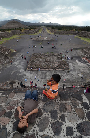Kids playing at the top of the sun pyramid at teotihuacan.