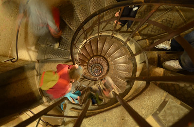 Going down the windy steps from the Arc De Triomphe in Paris,