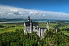 Neuschwanstein Castle in Bavaria, Germany, as seen from the trail above the footbridge that spans the waterfalls.